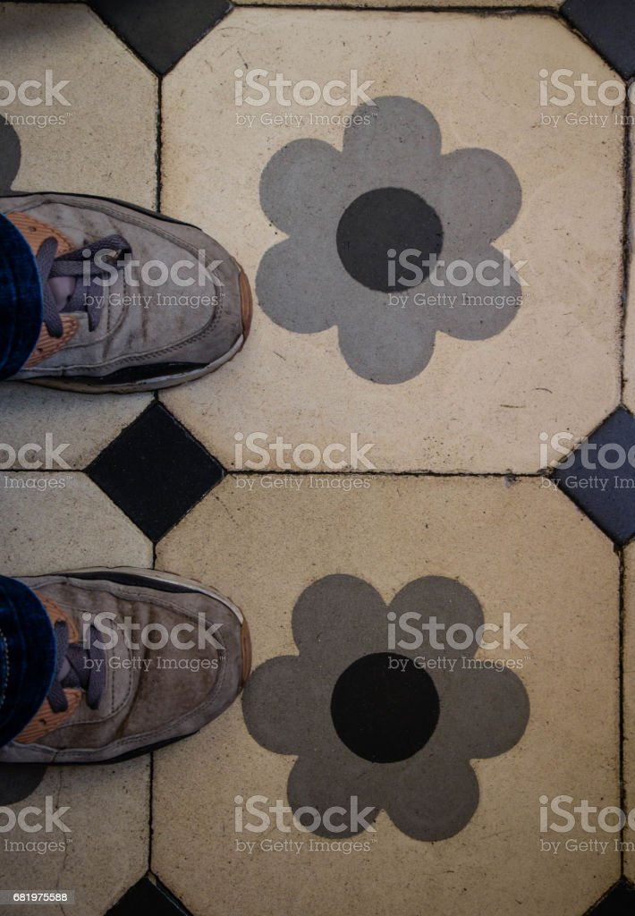 Standing, with my feet on a beautiful tiles with decorations of flowers. stock photo