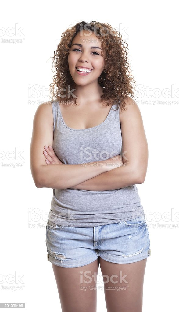 Standing woman from Venezuela with crossed arms and hot pants stock photo