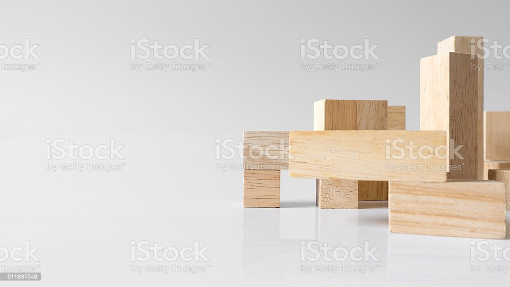 Standing wooden block puzzle of various shapes stock photo