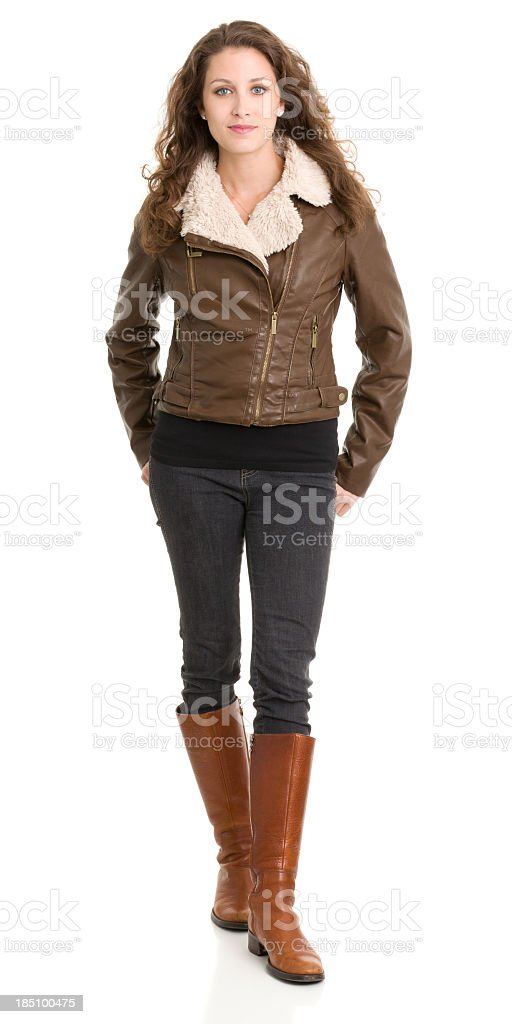 Standing Young Woman Looking At Camera With Blank Expression stock photo