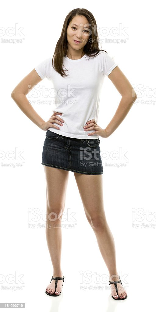 Standing Young Woman Posing With Hands On Hips stock photo