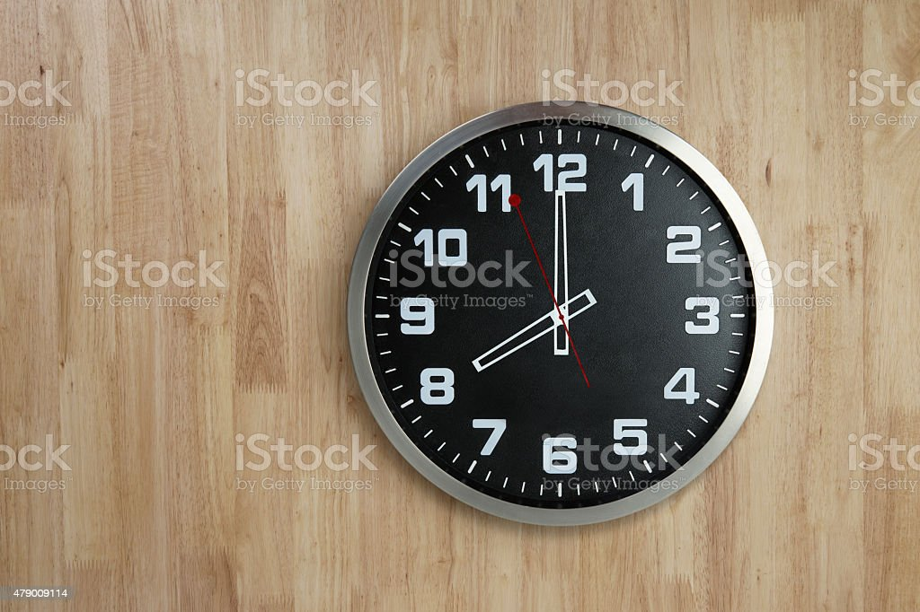 Standless Clock on Wooden Background, 8 O'Clock stock photo