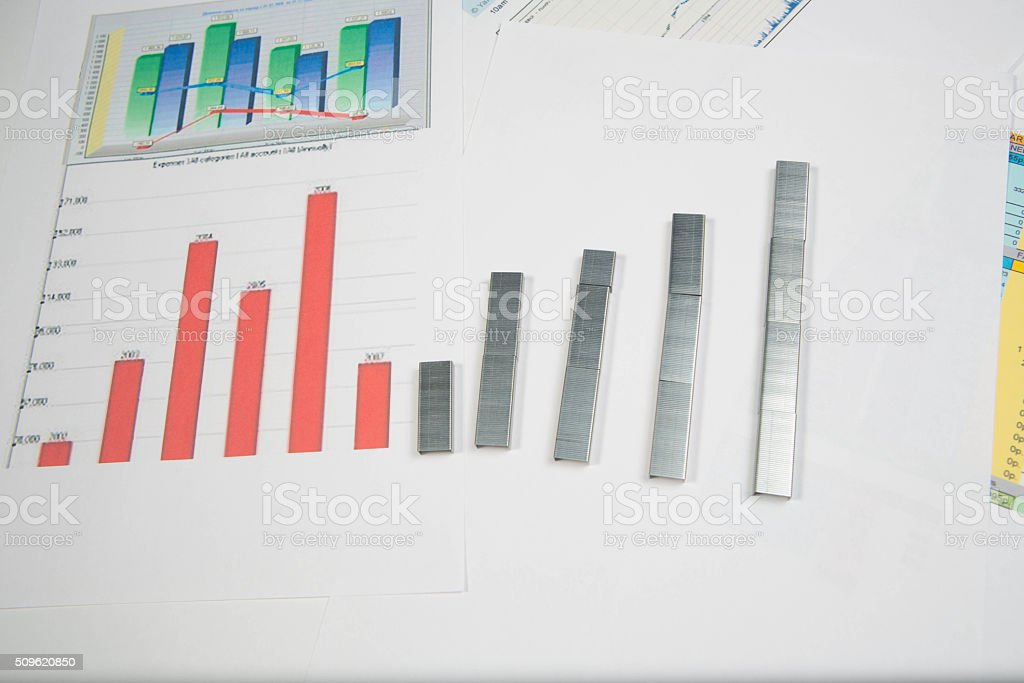 Staple strips arranged in the form of graph stock photo