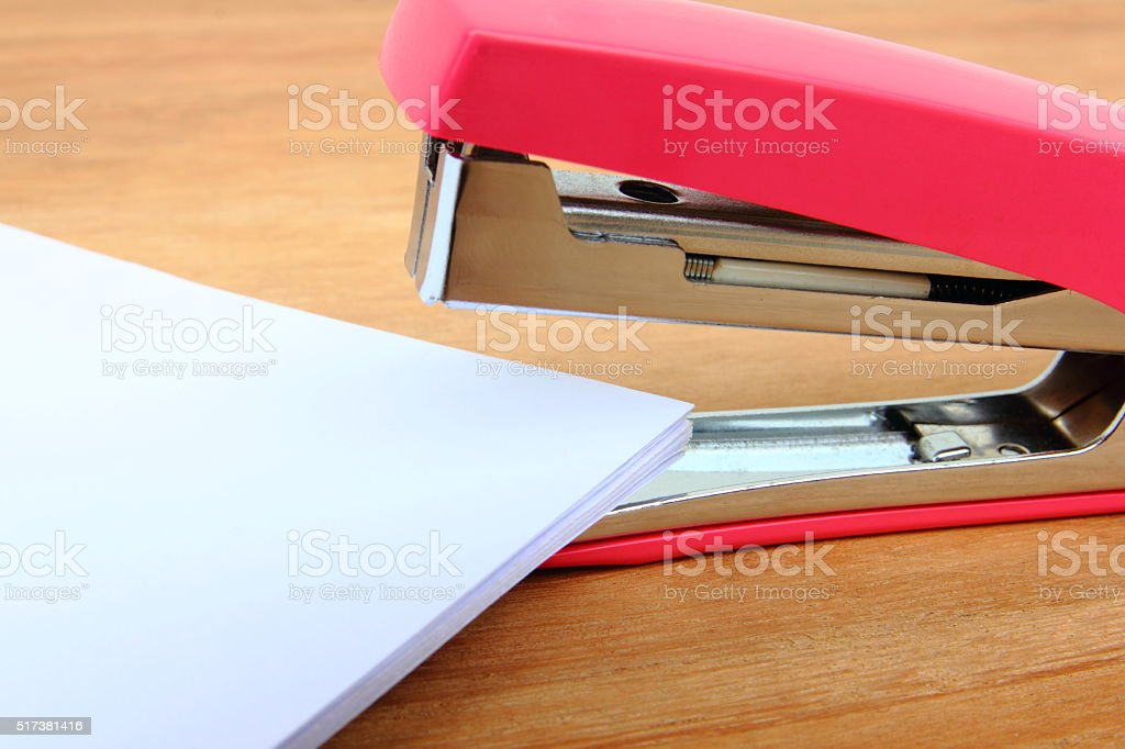 Stapler and paper stock photo