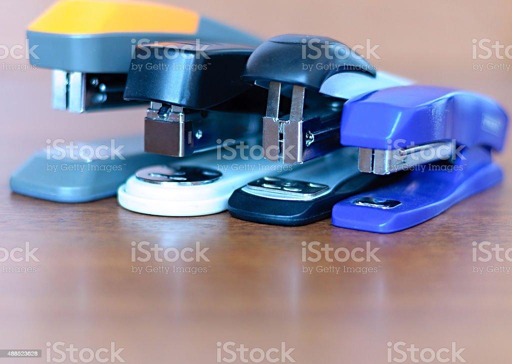 stapler on  wooden background stock photo