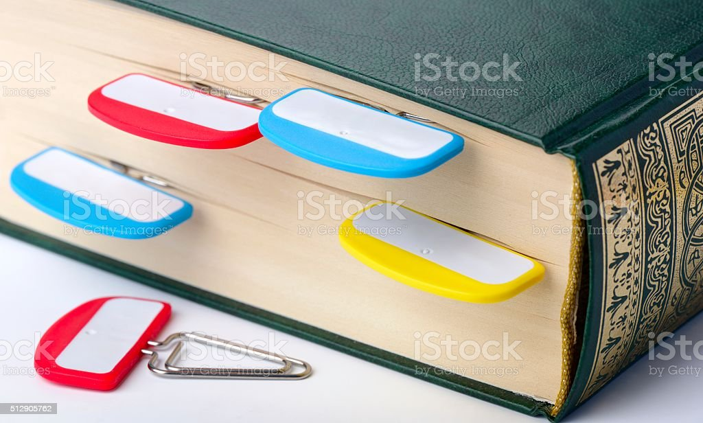 Staples with signs on a section of the book stock photo