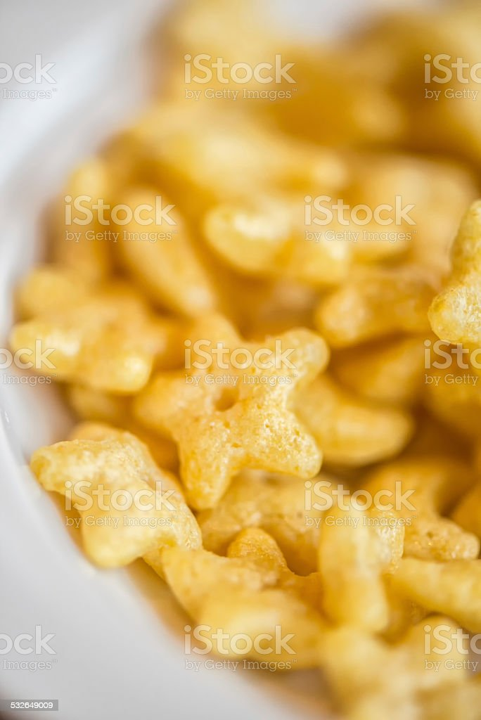 Star and Moon Honey Flavored Breakfast Cereal in Bowl stock photo