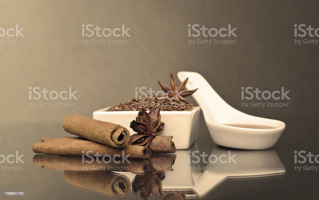 Star anise, cinnamon and flax royalty-free stock photo