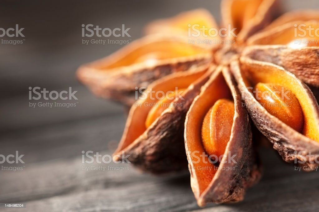 Star anise cooking spice drying on a bamboo mat stock photo
