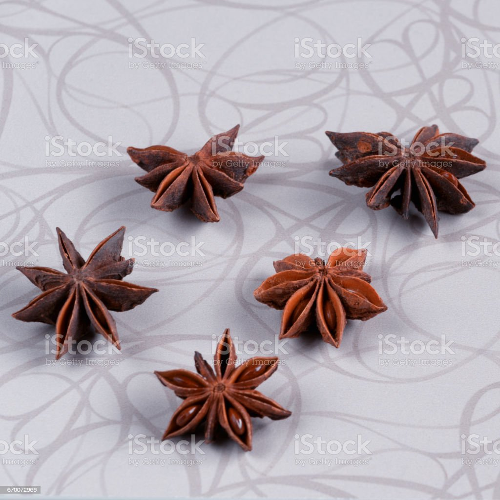 Star anise on white wooden background. stock photo