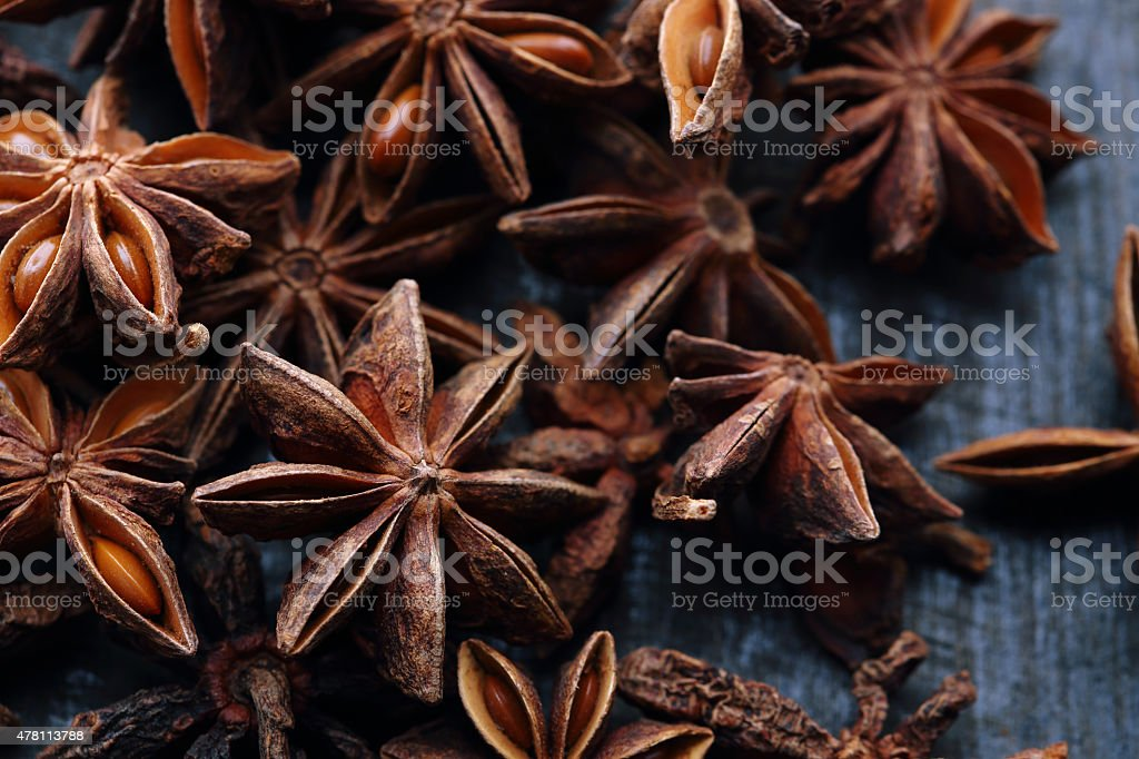 Star anise seeds on the wooden background stock photo