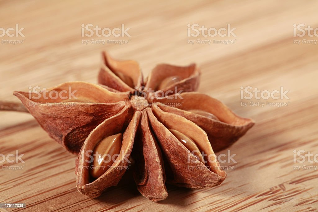 Star Anise spice on wooden background royalty-free stock photo