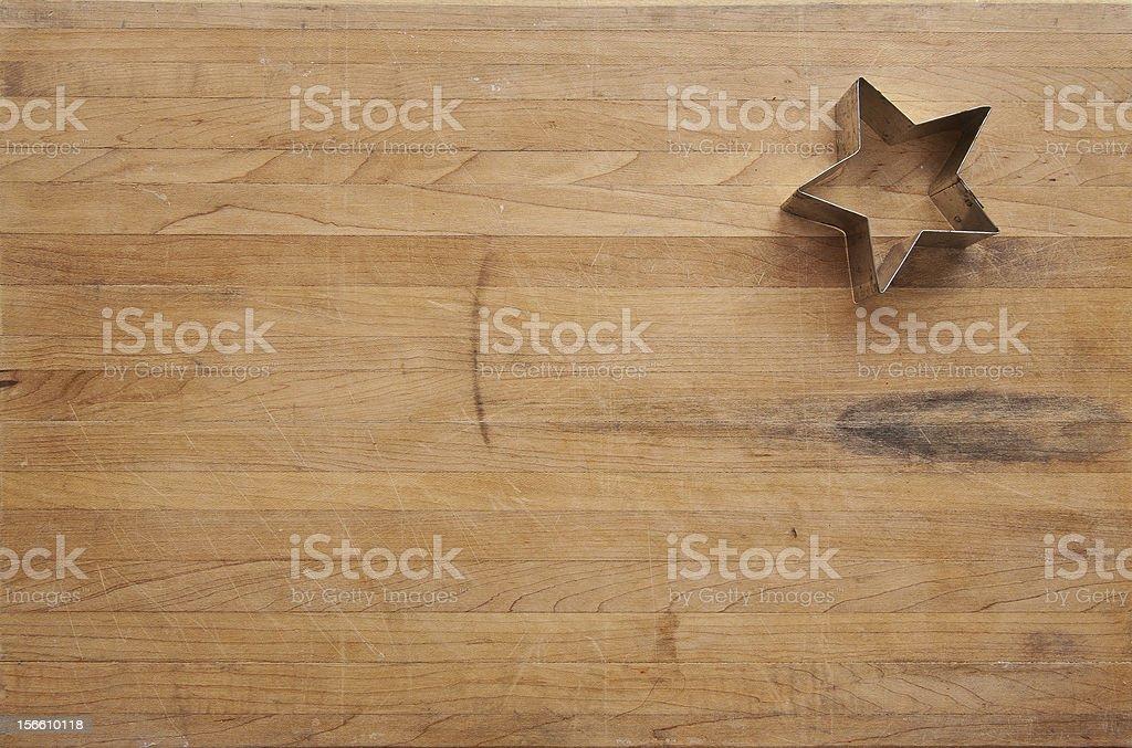 Star Cookie Cutter on Worn Cutting Board stock photo
