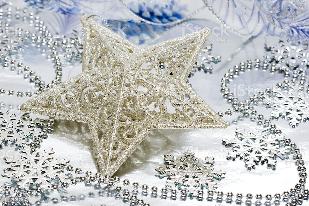 Star decoration on silver background royalty-free stock photo
