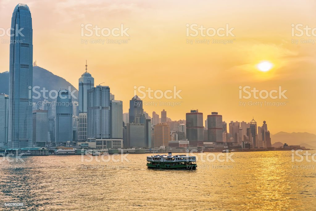 Star ferry at the Victoria Harbor of HK at sundown stock photo