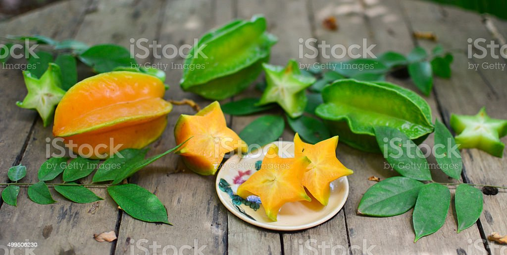 Star fruit on wood background ,starfruit on wood background stock photo