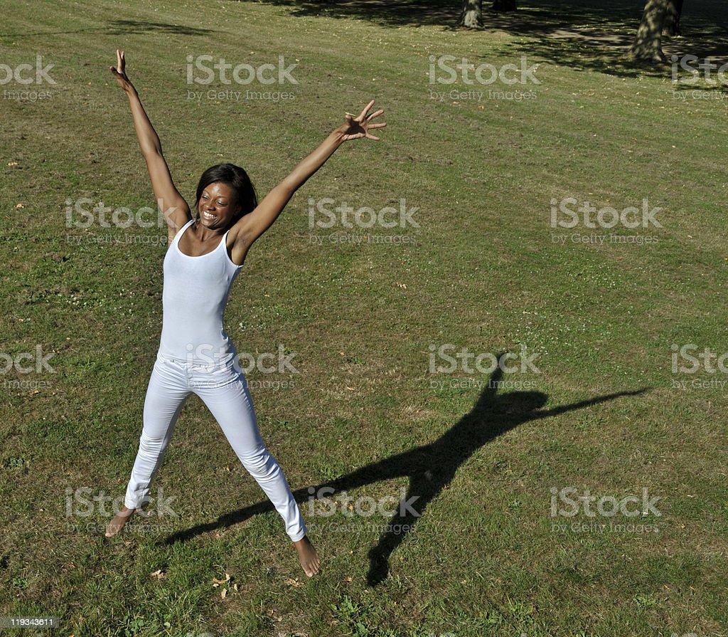 Star Jump Beautiful Black Girl stock photo
