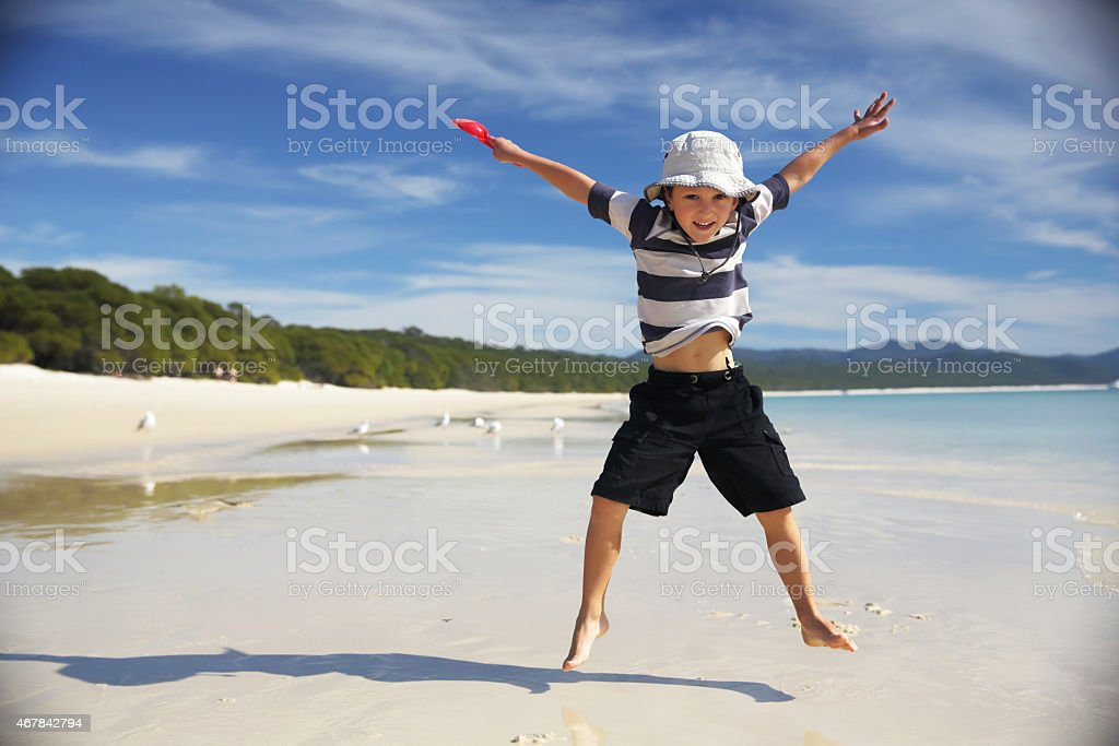 Star Jump on Whitehaven Beach, Whitsunday Islands, Great Barrier Reef stock photo