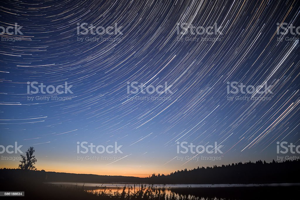 star lake sky forest tracks stock photo