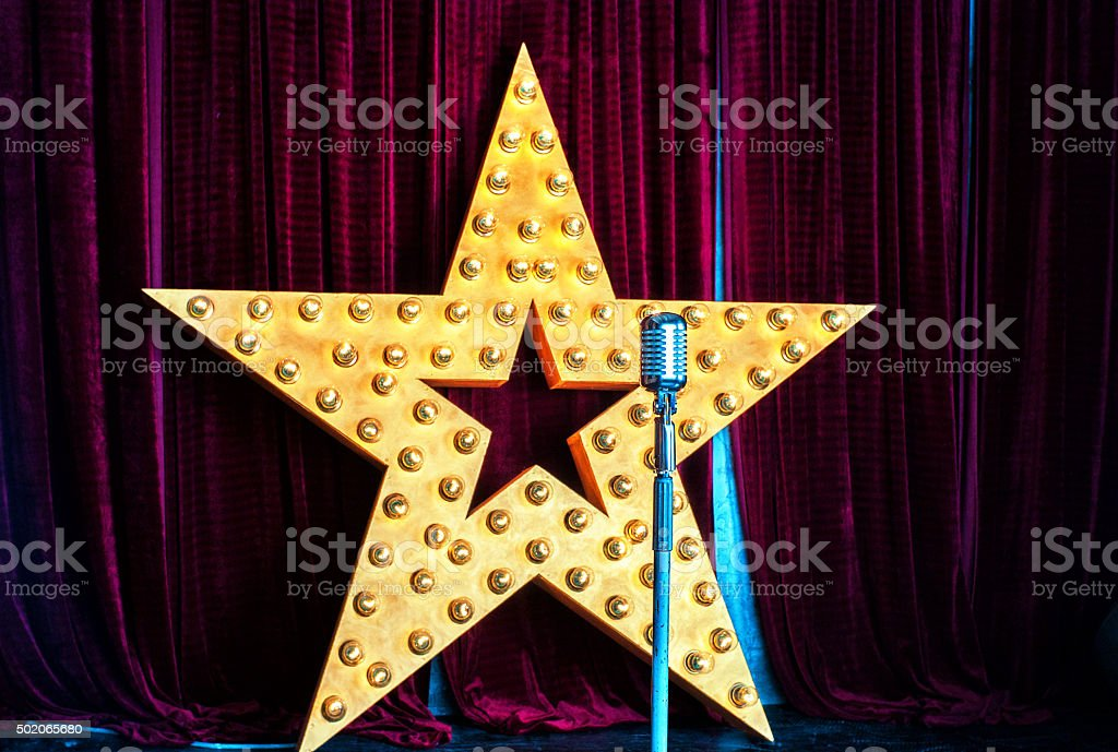 Star, microphone, stage stock photo