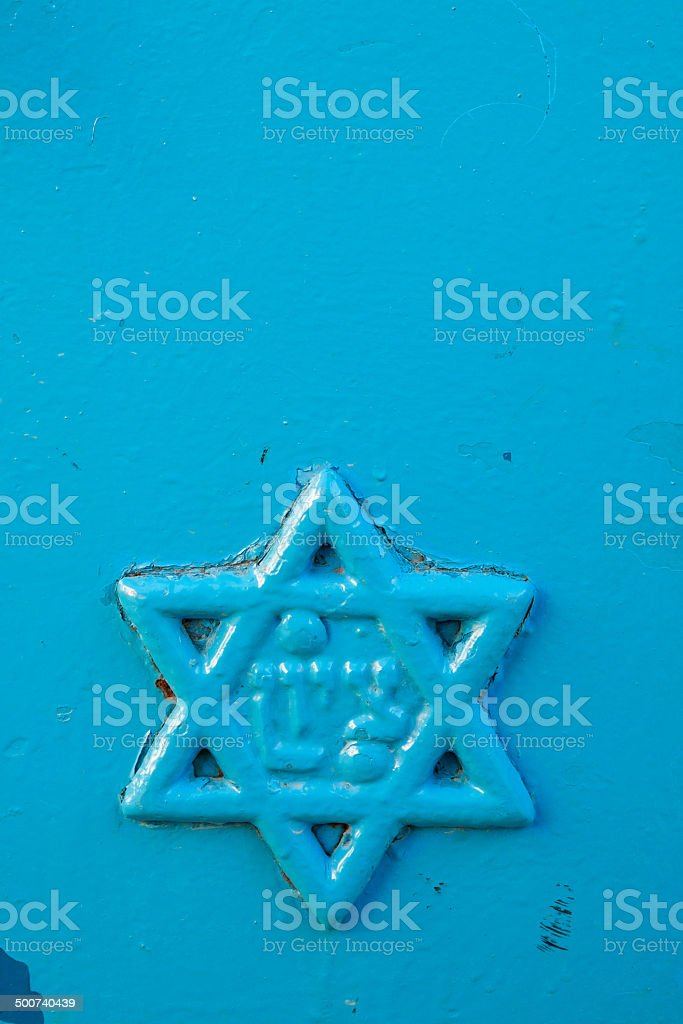 Star of David on blue door in Safed, Israel. stock photo