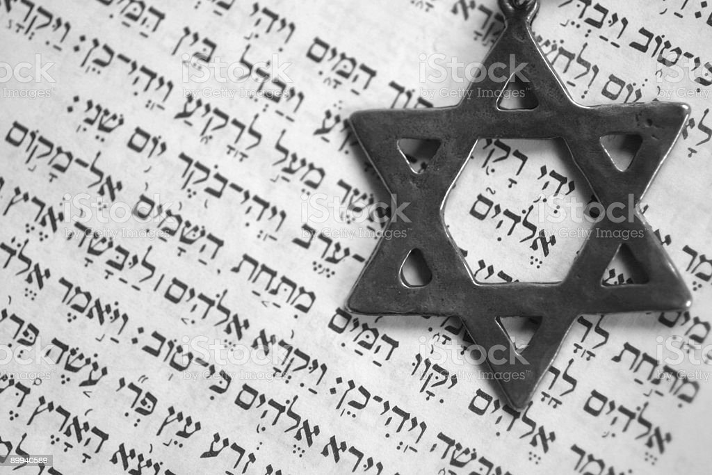 Star of David sitting on top of Hebrew text stock photo