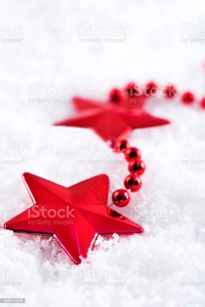 Star ornamental on artificial snow stock photo