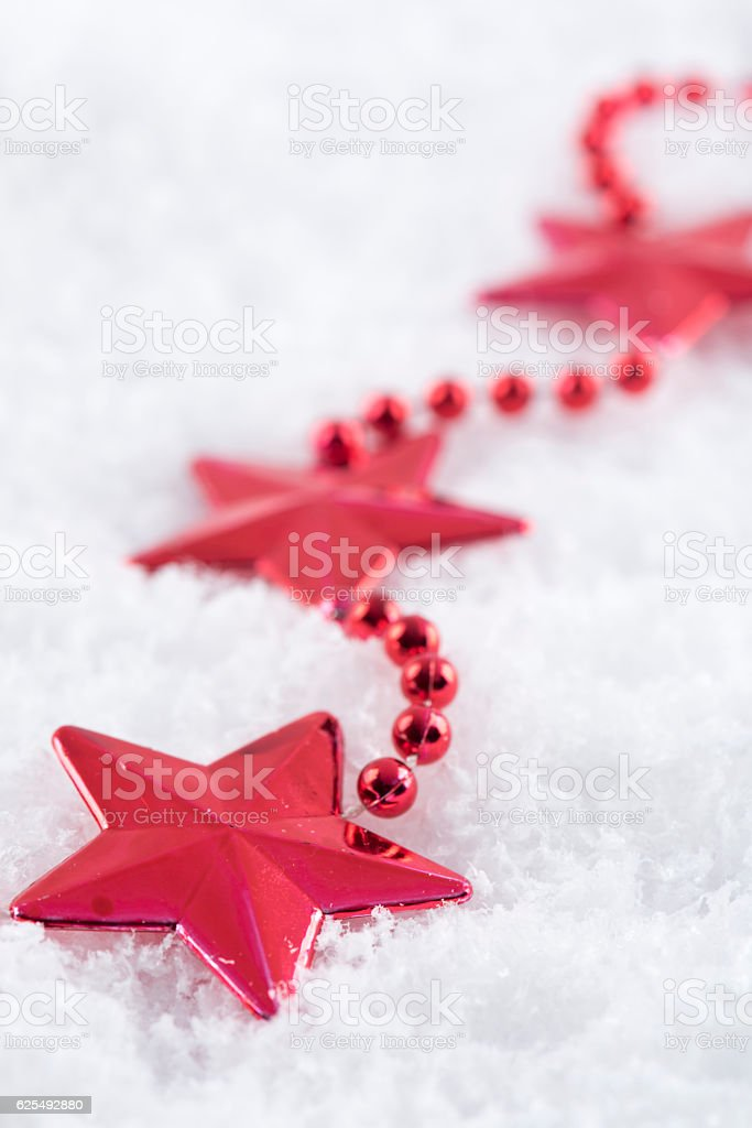 Star ornamental on artificial snow stock photo