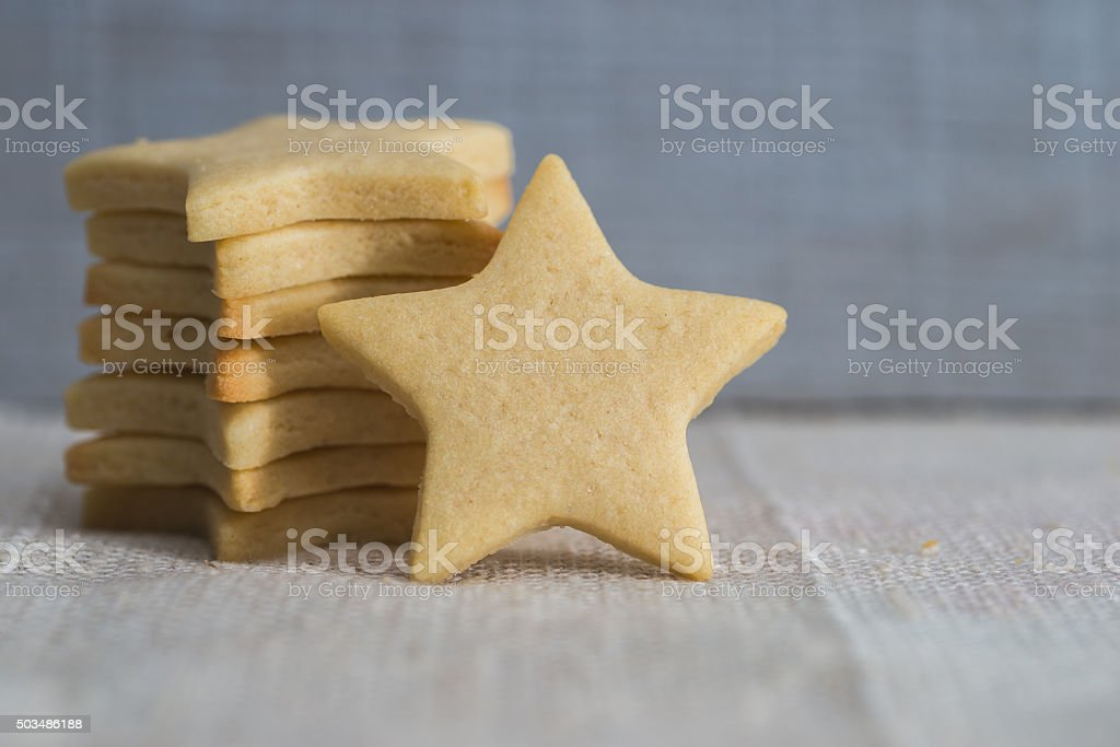 Star shaped butter cookies, Christmas pastry stock photo