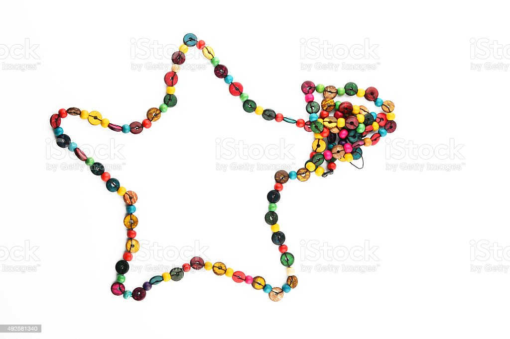 Star shaped colorful wooden beads necklace isolated on white royalty-free stock photo