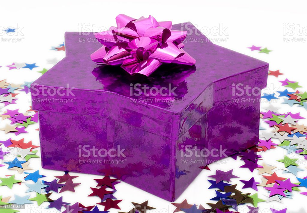 Star shaped gift box with a pink rosette royalty-free stock photo