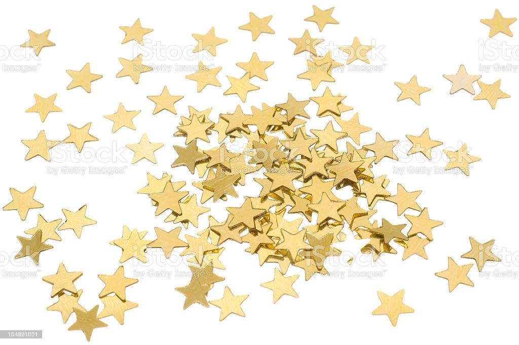 Star shaped golden confetti on white stock photo