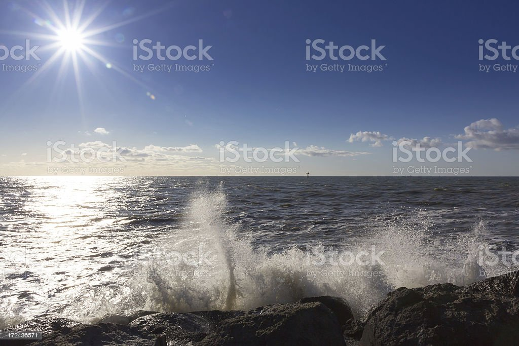 Star shaped sun and splashing waves royalty-free stock photo