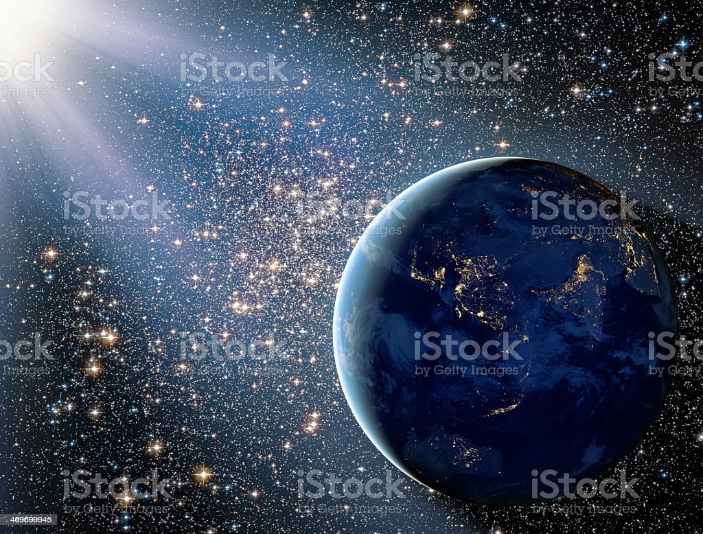 A star strewn background with Earth seen from space stock photo