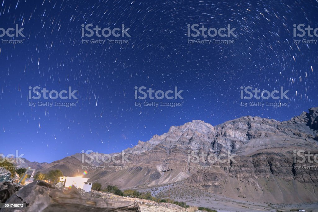 Star trail under himalayas stock photo