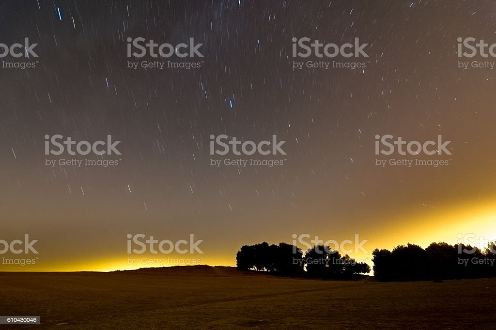 Star trails and meteors over the Israel Negev desert stock photo