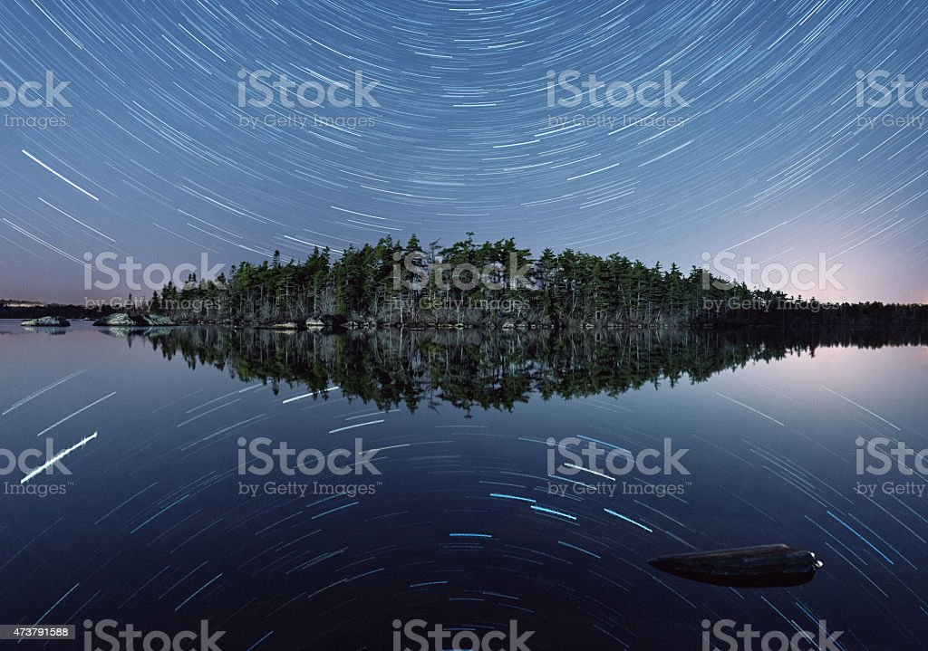 Star Trails Mirrored on Lake stock photo
