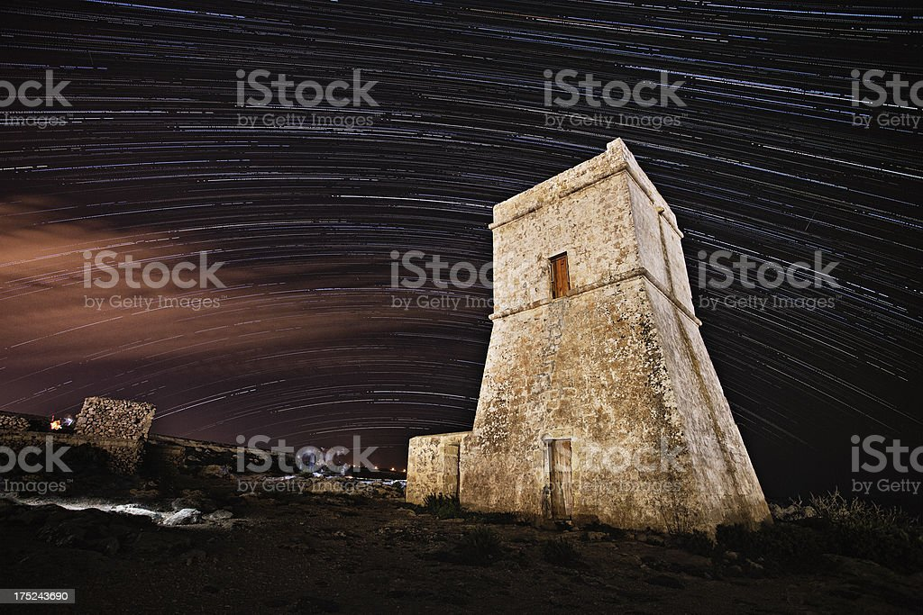 Star Trails over a coastal watch tower royalty-free stock photo