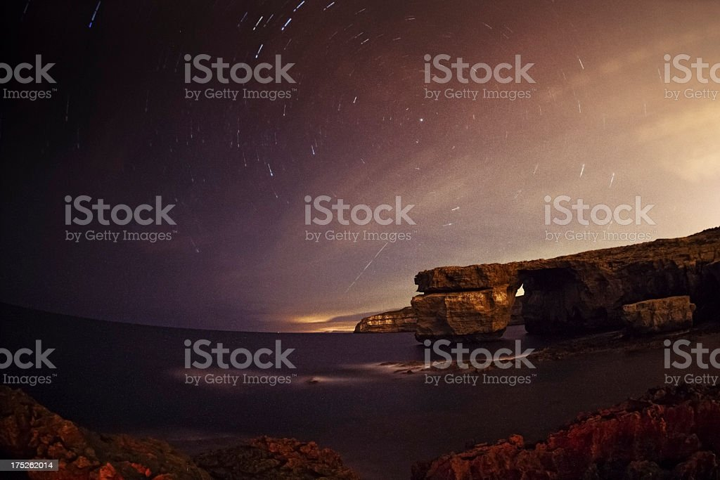Star Trails over a The Azure Window royalty-free stock photo