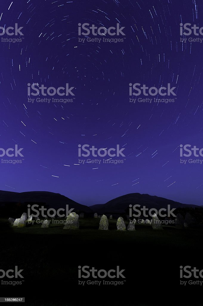 Star trails over ancient stone circle Castlerigg Lake District UK stock photo