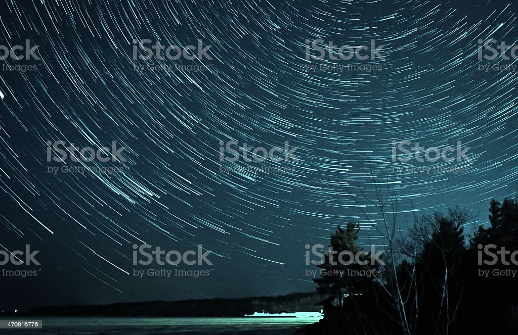 Star Trails over Frozen Lake stock photo