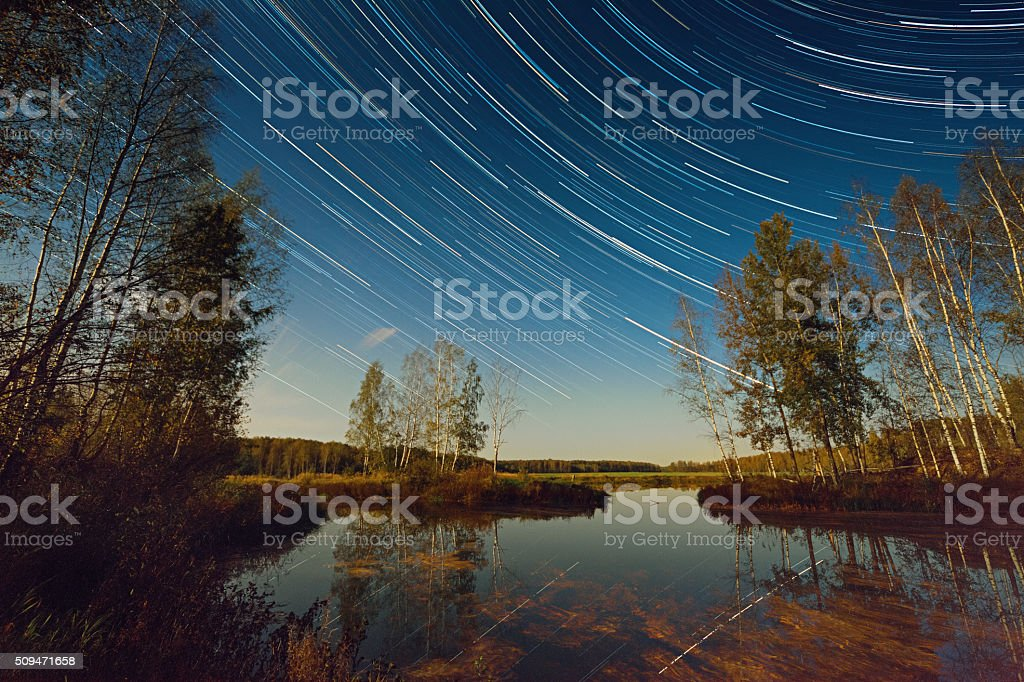 Star Trails Over Lake stock photo