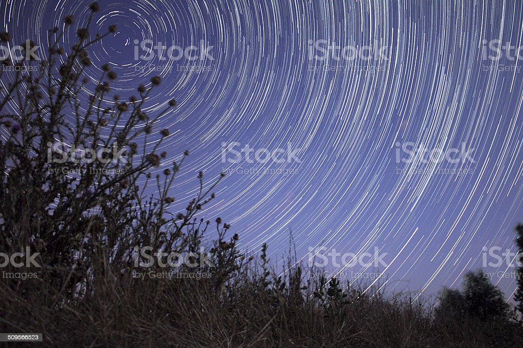Star trails over the field royalty-free stock photo