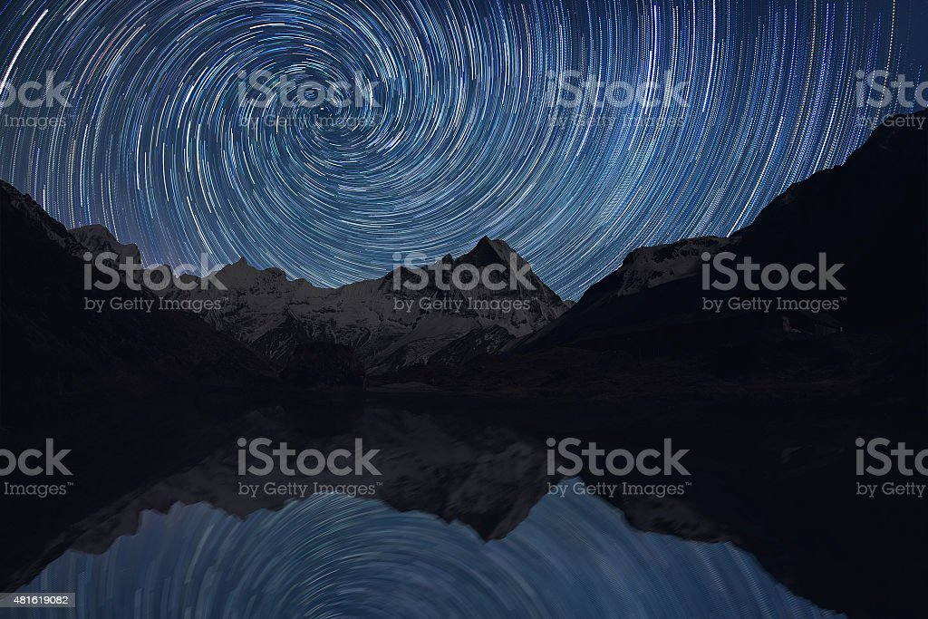 Star trails over the mountains stock photo