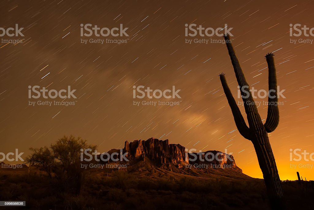 Star Trails with Saguaro Cactus. Lost Dutchman State Park. stock photo