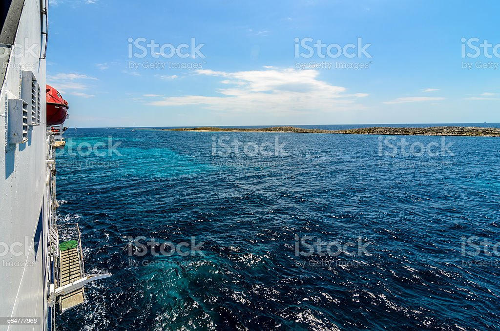 Starboard side of a ferry boat on the Adriatic Sea. stock photo