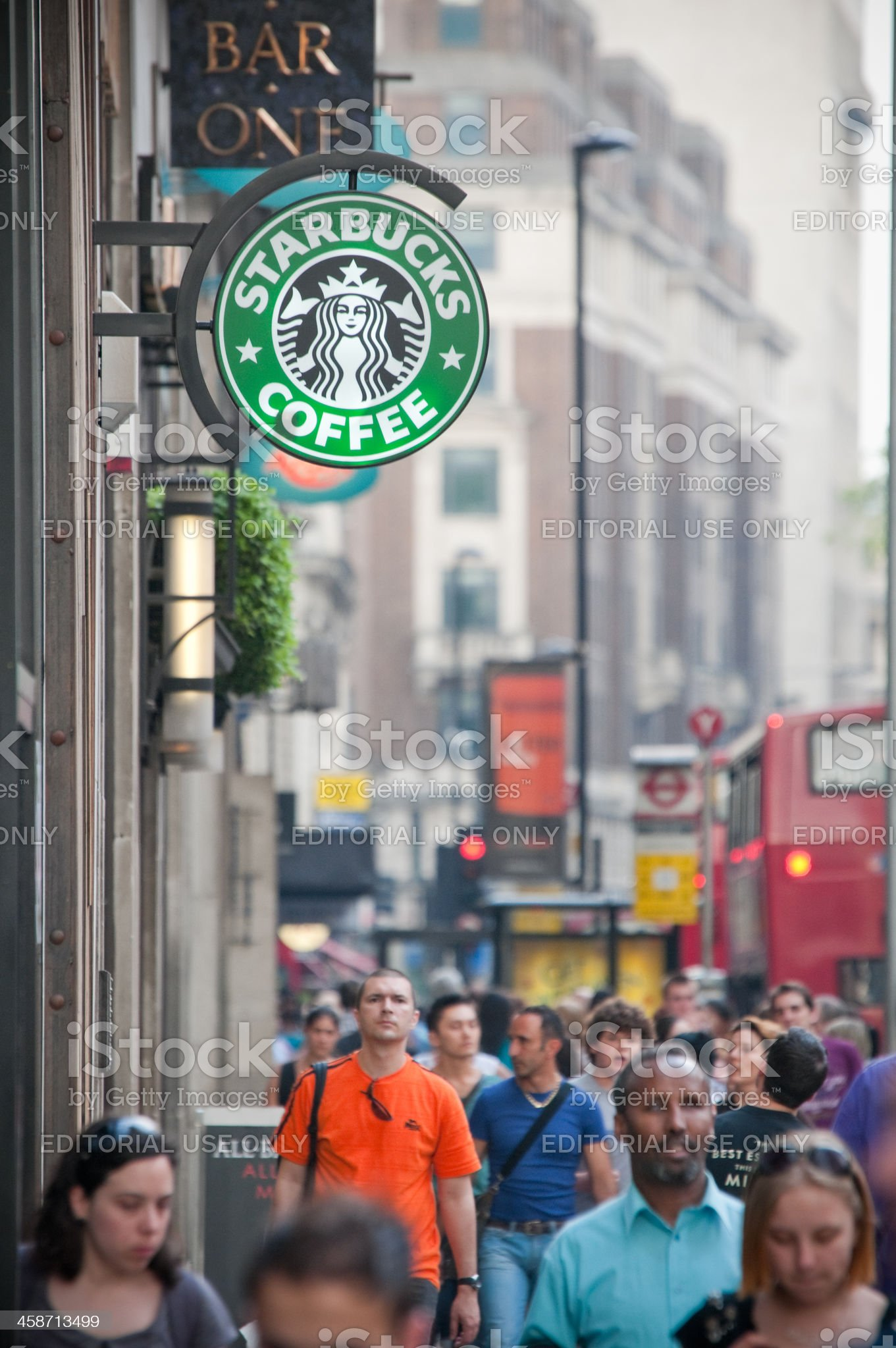 Starbucks Coffee House and pedestrians in central London, UK royalty-free stock photo
