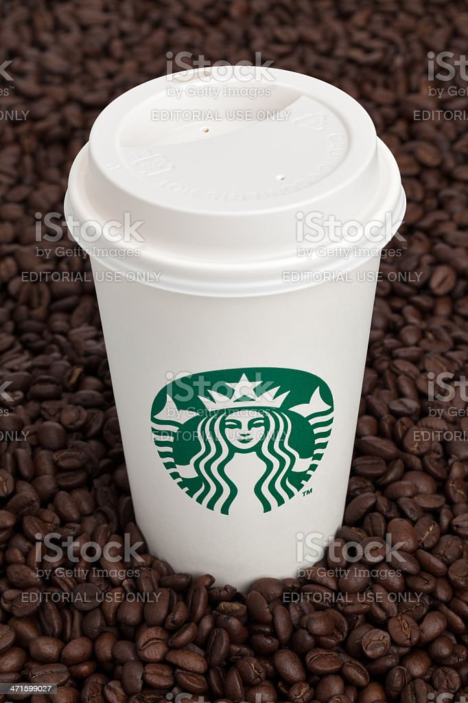 Starbucks Coffee on a Heap of Beans royalty-free stock photo