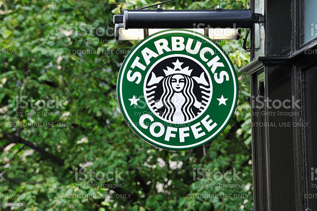 Starbucks coffee sign hanging outside a shop royalty-free stock photo