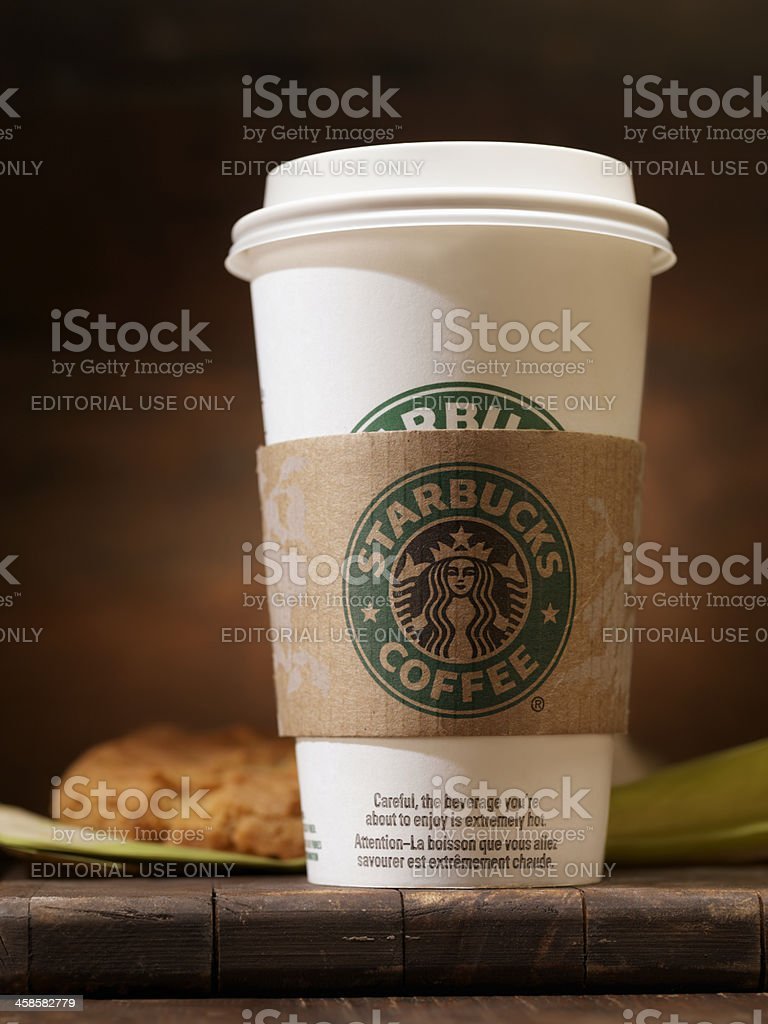 """Starbucks """"Grande"""" 16oz Coffee with a Peanut Butter Cookie royalty-free stock photo"""